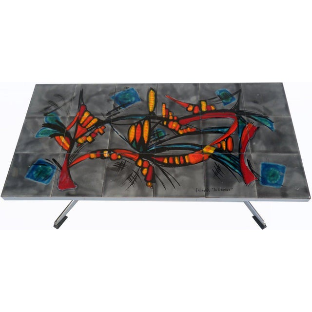 """French rectangular coffee table. Solid polished iron and original tiles. Signed VALLAURIS """" LA GRANGE"""" on the tiles."""