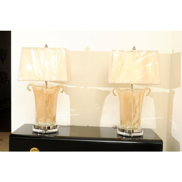 A stunning pair of large-scale Italian blown glass Murano vessels, circa 1970, as newly built custom lamps. Fabulous,...