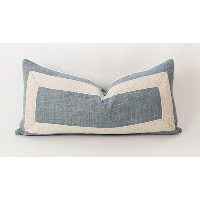 Light wedgwood blue linen lumbar pillow with ivory and cream Greek key tape framing the front. Solid blue linen back,...