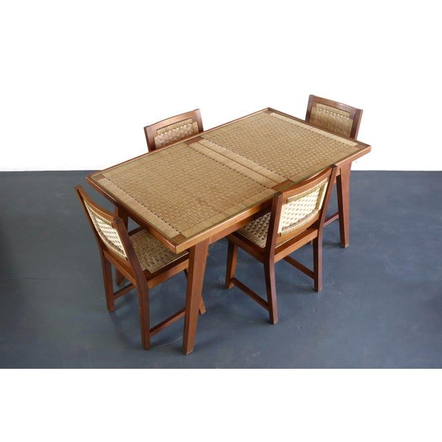 About the Articulate Woven Mid Century Dining set in Teak with Glass Top Table Stunning Table with Set of four wonderfully...