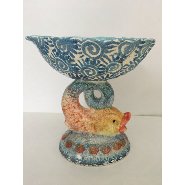 Lovely hand painted ceramic shell bowl perched atop a Dolphin tail made in ITALY. Partly, sponge painted and brightly...