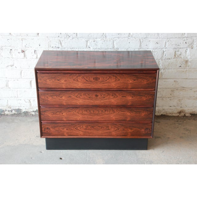 Offering an amazing Norwegian rosewood bachelor chest or dresser by Westnofa. This four drawer chest has an incredible...