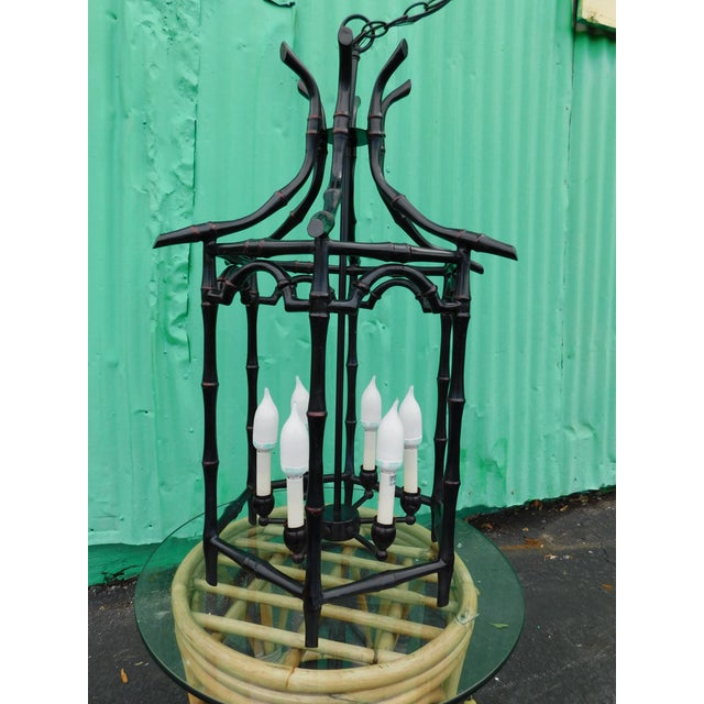 Gorgeous newer large black pagoda faux bamboo chandelier with 6 lights. There are very few scrapes and scuffs to the as...