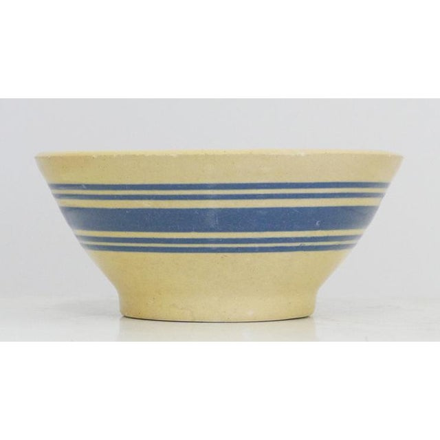 Blue Stripe Antique Yelloware Bowl American in Origin. Circa late 1800s to Early 1900s. It has hand decorated with 5 Color...