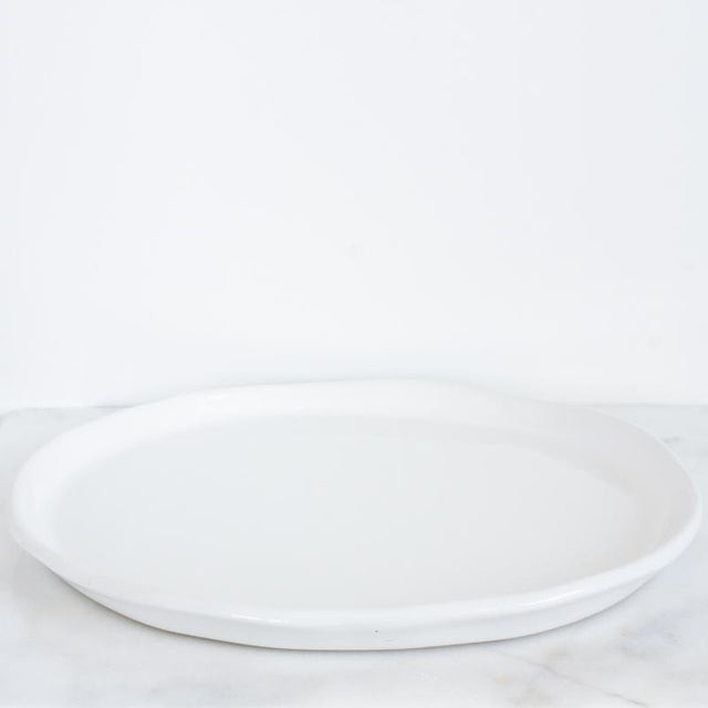 Brand new showroom sample stoneware platter glazed in a creamy, ivory white glaze over a gray stoneware clay body. This...