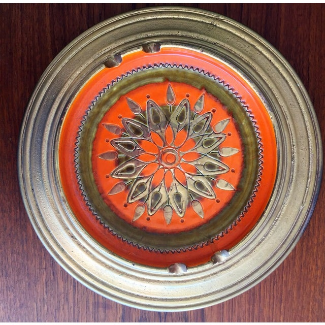 Beautiful vintage Bitossi starburst Italian art pottery ashtray. It is orange and gold with floral/star incised interior....