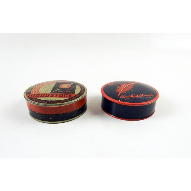 Two art deco typewriter ribbon tins circa 1930's. Woodstock and Redfeather. Both clean inside, some scratches and wear.