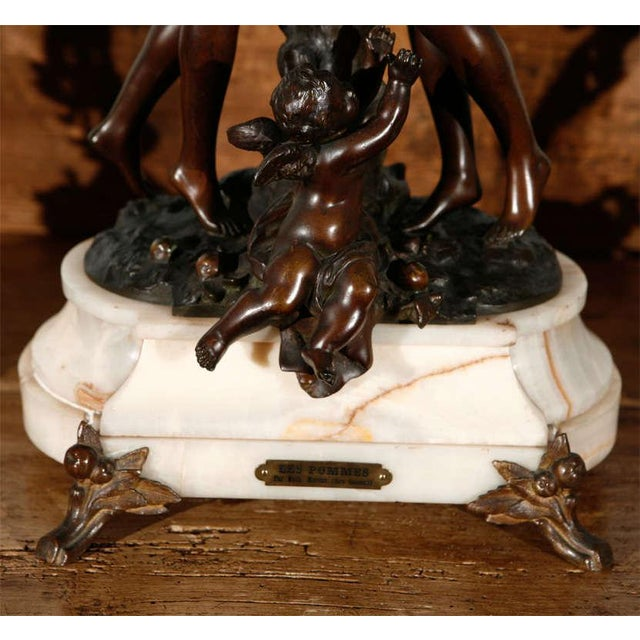A large and imposing French, 19th century, figural three piece clock set having a pair of five light candelabra. All...