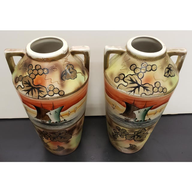 Up for sale is a Pair of Circa 1910 Japanese Royal Nippon Porcelain Sailing Ship/Grapevine Motif Vases! They each measure...