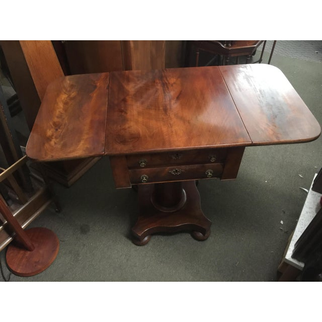 Beautiful Mahogany Work table, or sewing table, Empire Style , Circa 1870 with original key. Table has two fold down...
