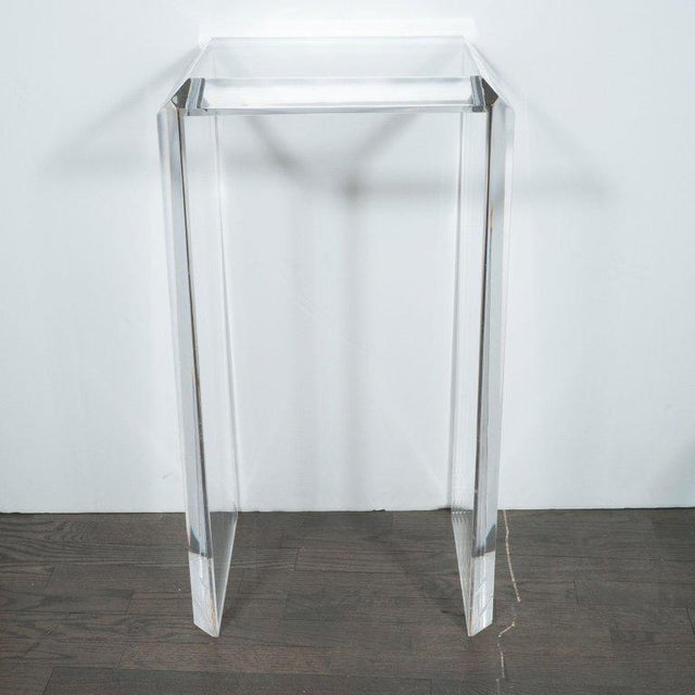 This refined Mid-Century Modern pedestal was realized in the United States, circa 1970. It features a square top with...