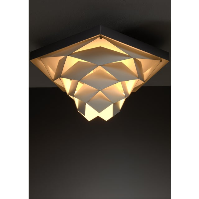 A 'Symfoni' ceiling lamp by Preben Dahl for Hans Følsgaard Belysning. These metal flush mount lamps are made of a grey...
