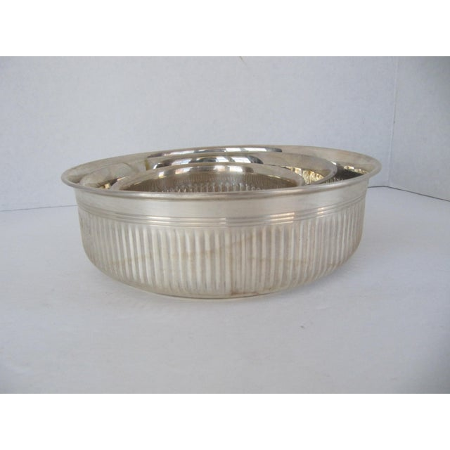 Set of three silver-plate serving bowls. Great for hot or cold foods and for serving at a formal or casual gathering....