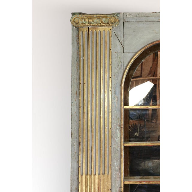 A Whimsical Painted Italian Architectural Element fitted as a Bookshelf with gilded Ionic columns on either side, arched...