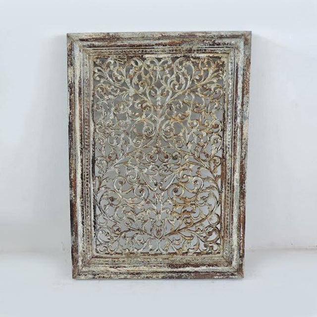 Beautiful carved scroll open work panel with distressed white painted finish.