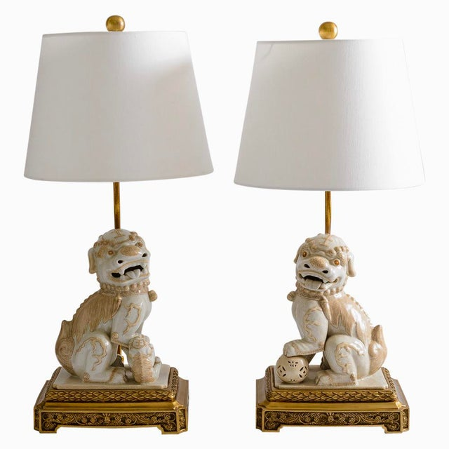 Eye-catching pair of Foo Dogs in an off-white color with a natural crackled finish. They stand on a very elaborate large...