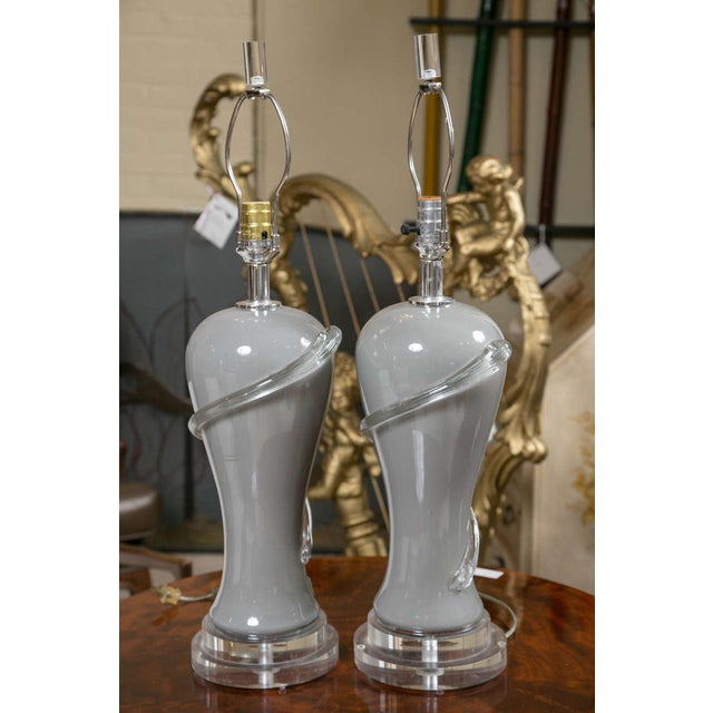 Pair of gray glass table lamps with lucite bases. Modern design with a great neutral palette to compliment any design...