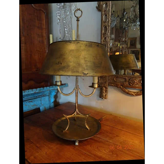 Fabulous pair of late 19th Century French gilded iron bouillotte lamps. Stands on three little feet. Shade is gilded tole....
