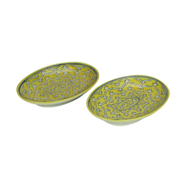 Pair of Jaipur decorative ceramic platters hand-painted with floral designs. Finished with a glass glaze. No maker's mark....