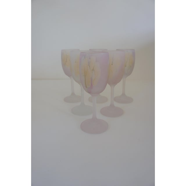 Set of 6 - wine glasses in a watercolor pattern, made by Reuven. Subtle pinks, yellows and oranges reminiscent of fall...