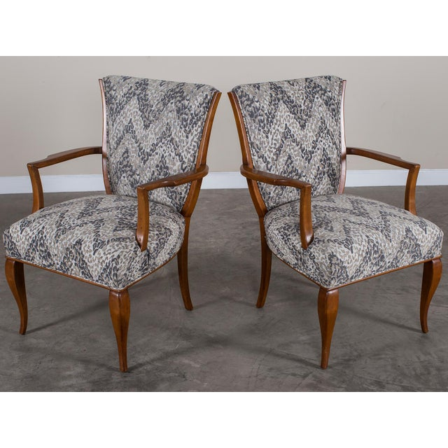 A pair of vintage French Art Deco beechwood armhairs circa 1940 now reupholstered in a contemporary fabric. Please notice...