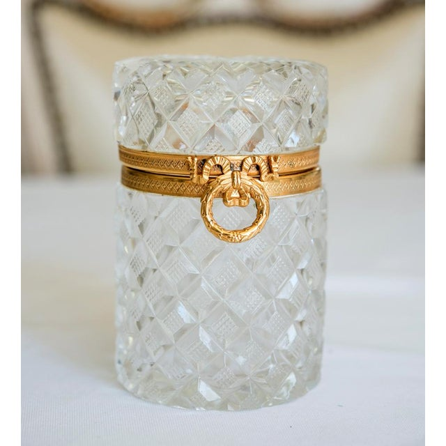 Beautiful antique French cut crystal round trinket box. The charming box features a Charles X style displaying a diamond...