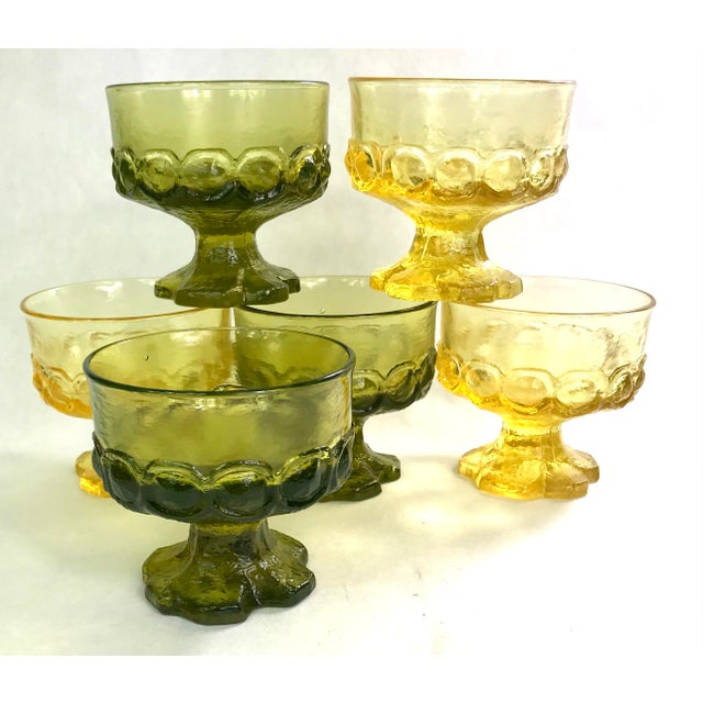 Bold set of six goblets in olive green and cornsilk yellow. A great heavy vintage set of glasses with biomorphic brutalist...