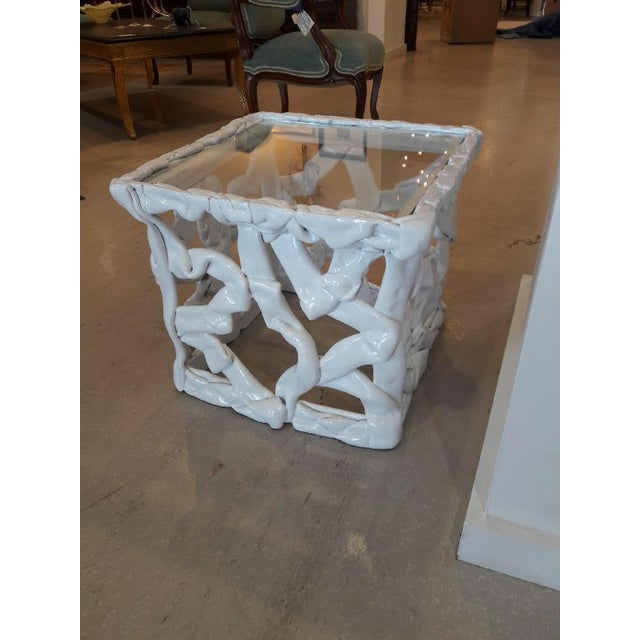 White taffy cube table with inset square glass. In the style of Tony Duquette.