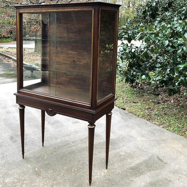 Antique French Louis XVI Vitrine is the perfect choice for displaying your most prized possessions, collection or family...