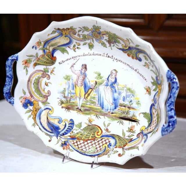 This beautiful antique faience dish was crafted and painted in Normandy, France, circa 1880. The stylized ceramic plate...