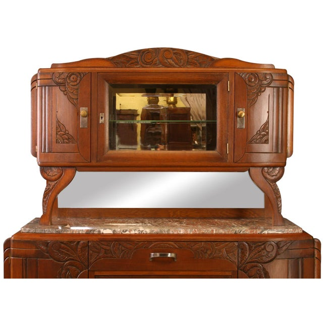 Offered is a beautiful French art deco style buffet circa 1920s. This piece is made from oak and walnut with beautiful...