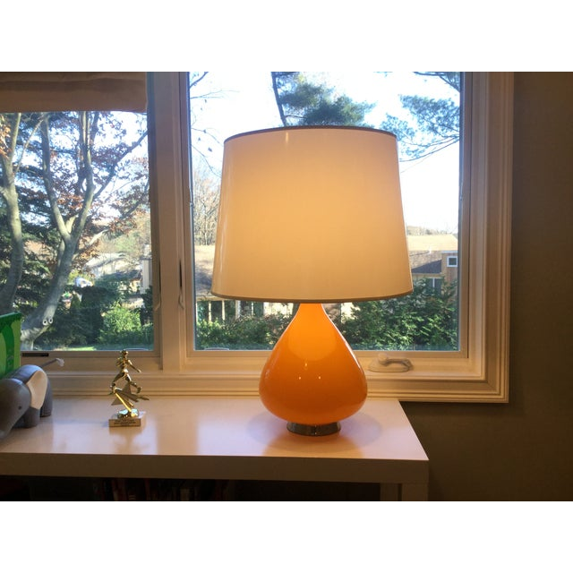 Orange teardrop Table Lamp by Robert Abbey for Jonathan Adler. Full range dimmer, parchment shade, polished nickel fittings.