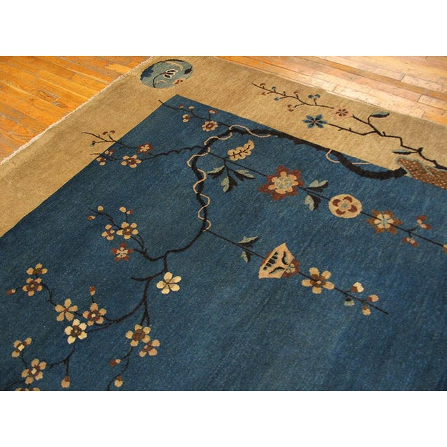 "This is a chinese art wool rug from china 1920. The size is 9'x11'10"". The colors are blue, tan, brown, green, and cream...."