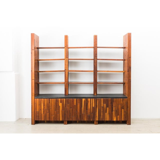 Custom Wall Mount Console and Shelving by Phillip Lloyd Powell, circa 1960's, USA. Unique carved walnut case with four...