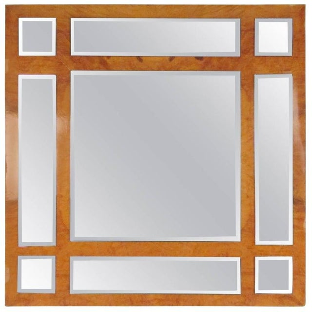This stunning vintage mirror by Gary Copeland features burl wood finish and bevelled mirror panels. Unique artistic wall...