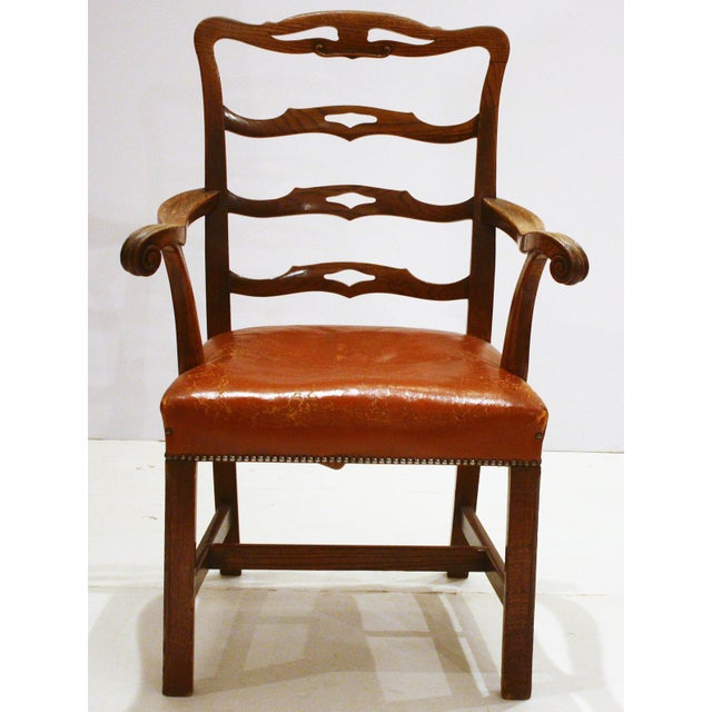 an English host / arm chair with pierced rung ladderback and straight Marlborough legs (H-stretcher), British tan saddle...