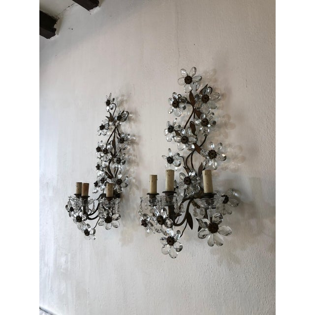 Housing three lights each, sitting in crystal bobeches dripping with crystal beads. Rewired and ready to hang. Brass...