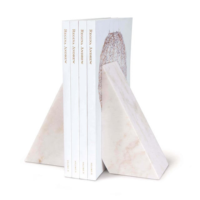 Stylize your reading materials with these marble bookends, perfect for a living room bookcase or a desk in your office....