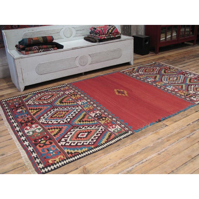 A superb antique kilim that would have been draped over the leading camel of a nomadic caravan, to show off the skills of...