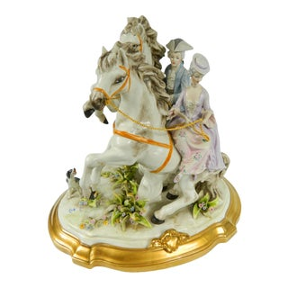 1980s Hand Painted Capodimonte Statue With Man and Woman Riding Horses For Sale
