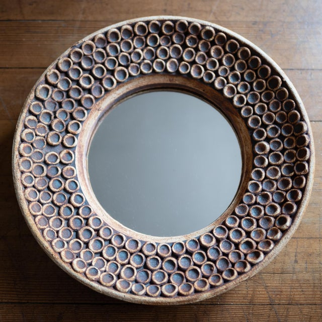 Ceramic wall mirror from the 1960s. Expertly crafted but unsigned.