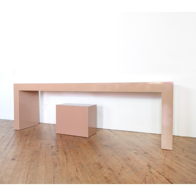 Immaculate shiny laminate console with matching plinth/seat. 7 ft long. Neutral coco mauve color. Changes in different...