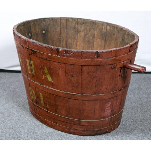 From the vineyards of France, a charming wooden staved bucket with iron handles and rings. This was used to gather grapes....