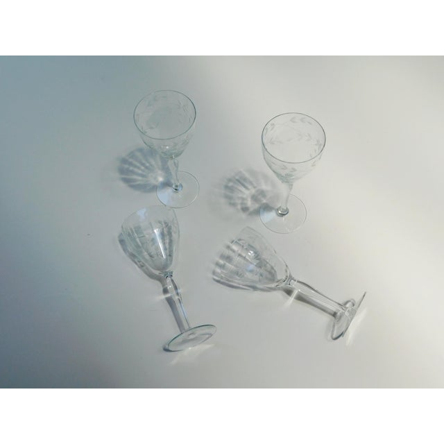 "Sweet sophisticated etched wine glasses. 7 3/4"" tall x 3 1/4"" round at top x 2 3/4"" round at base Handmade circa: 1940's"