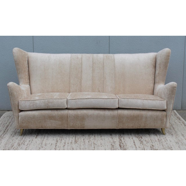Fabulous 1950's Gio Ponti Style wingback sofa with brass legs, newly upholstered in chenille.