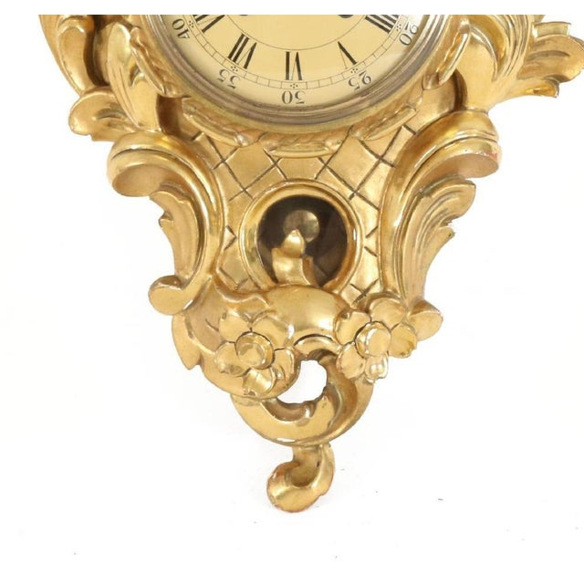 Rococo style wall clock from 1900. This hand carved wall clock has been gilded and bears the name of its clocksmith: Hugo...