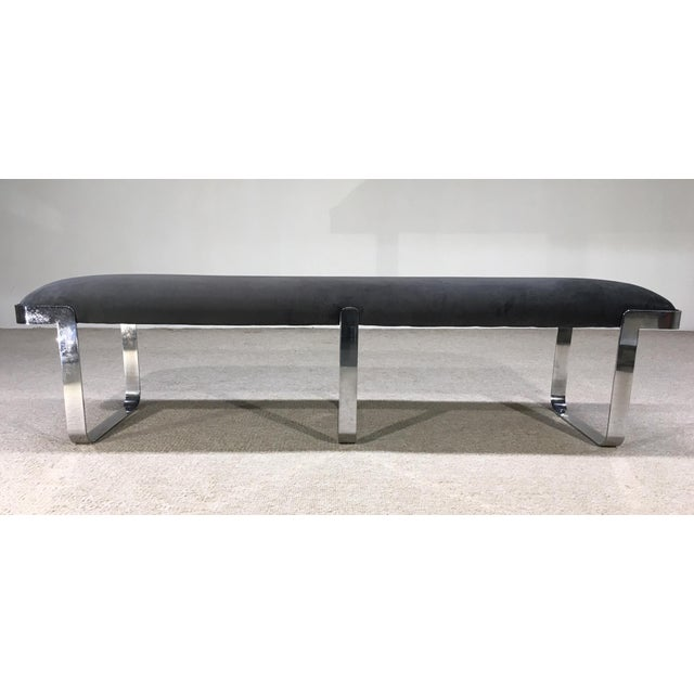 A chrome plated steel rectangular bench manufactured by TriMark Designs of Philadelphia ca 1960. The curved legs of the...