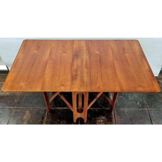 Vintage UK Modern gateleg, drop leaf Sutherland type table in the manner of Norwegian designer Bendt Winge, who designed...