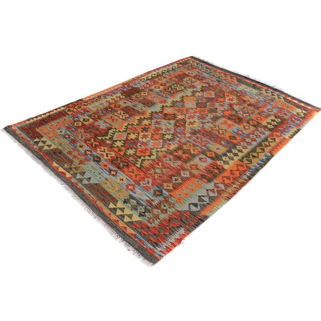 Add a touch of elegance to your home with this casual chic hand woven Tribal Kilim wool rug. Constructed on a loom by...