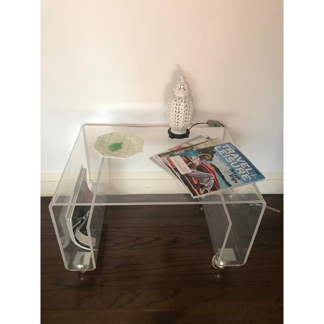 Great side table that also works as a magazine rack. It is on casters so easily movable and can hold magazines or books on...